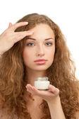 Woman applying moisturizing cream — Stock Photo