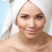 Pretty young woman with towel on her head — Stock Photo