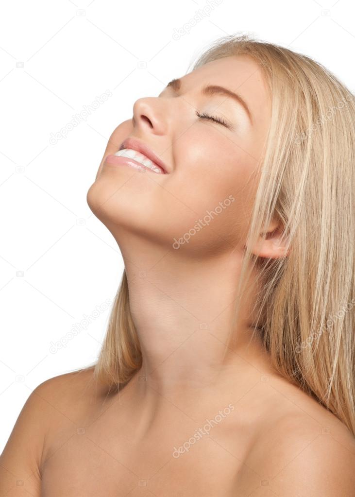 Close-up portrait of  beautiful smiling blond girl with closed eyes, isolated on white — Stock Photo #15534089