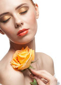 Woman with make-up and rose — Stock Photo