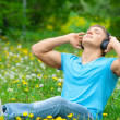 Portrait of a young man listening to music outdoors — Stock Photo #15608923