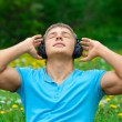 Portrait of a young man listening to music outdoors — Stock Photo #15608931