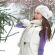 Winter woman behind snow tree — Stock Photo #15608977