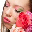 Woman with makeup and roses - Stock Photo