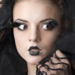 Fashion model with artistic black make-up - Stock Photo