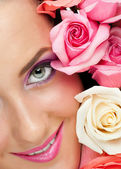 Close-up of beautiful woman with roses — Stock Photo
