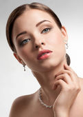 Beautiful woman with pearl necklace — Stock Photo