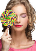 Beautiful girl with lollipop — Stock Photo