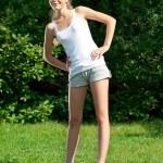 Girl doing stretching exercise — Stock Photo #15639815