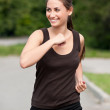 Young woman running in park — Stock Photo #15639819