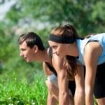 Fitness couple ready to start running — Stock Photo #15640057
