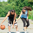 Young couple playing basketball — Stock Photo