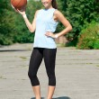 Young athlete with basketball — Stock Photo