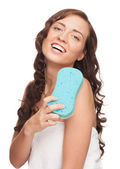Woman with bath sponge — Stock Photo