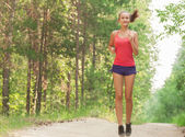 Young woman jogging outdoors — Stock Photo