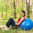 Woman exercising with fitness ball — Stock Photo #16896255