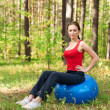 Woman exercising with fitness ball — Stock Photo