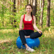 Woman exercising with fitness ball — Stock Photo #16896325