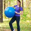 Royalty-Free Stock Photo: Woman exercising with fitness ball