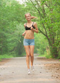 Fitness woman jogging — Stock Photo