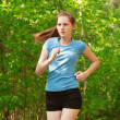 Athlete woman jogging in park — Stock Photo