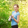 Royalty-Free Stock Photo: Woman drinking water after workout