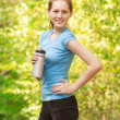Woman drinking water after workout — Stock Photo