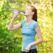 Woman drinking water after workout — Stock Photo #16901019