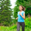 Athlete woman jogging outdoors — Stock Photo