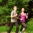 Woman and man jogging in park — Stock Photo