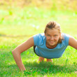 Woman doing push up exercise - ストック写真