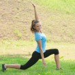 Woman doing sports stretching exercise — Stock Photo #16909955