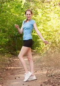Fitness woman with skipping rope — Stock Photo