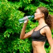 Woman drinking water after fitness — Stock Photo #16910057