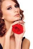 Schöne frau mit rose — Stockfoto