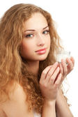 Woman with jar of moisturizing cream — Stock Photo