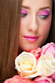 Woman with make-up and roses — Stock Photo