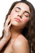 Beautiful woman touching her face — Stock Photo
