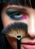 Woman with colorful stylish make-up — Stockfoto