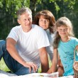 Happy family having picnic — Stock Photo