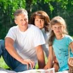 Happy family having picnic — Stock Photo #17632221