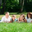 Family lying on grass - Lizenzfreies Foto