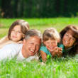Family lying on grass — Stock Photo #17632243