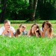 Family lying on grass — Stock Photo #17632251