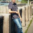 Portrait of stylish young man outdoors - Photo