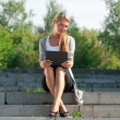 Business woman using laptop outdoors  — ストック写真