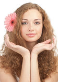 Beautiful woman with flower in her hair — Stock Photo