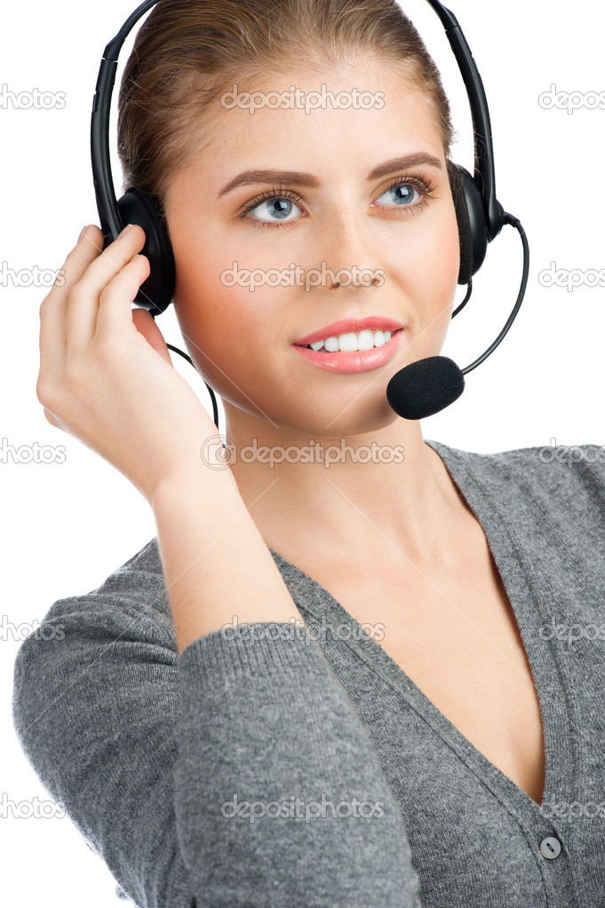 Portrait of pretty female call center employee wearing a headset, against white background  Stock Photo #17638441