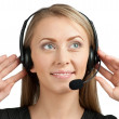 Portrait of a pretty female call center employee - Stock Photo
