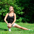 Woman doing stretching exercise — Stock Photo #17641779